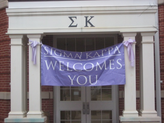 Large sorority banner hanging across building front