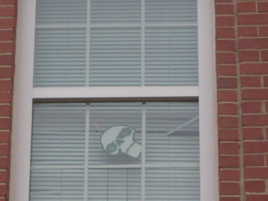 Skull decal in Auburn dorm window