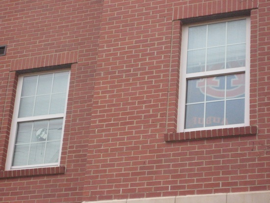 Auburn flag hanging in Auburn dorm window